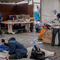 Refugees in the Jungle of Calais  in France Rashid a sudanese migrant in his tent with others on 23 October 2016. It was their last day at the camp.