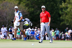 September 24, 2017 - Atlanta, Georgia, United States - Jon Rahm (R) and his caddie, Adam Hayes, walk the first green during the final round of the TOUR Championship at the East Lake Club. (Credit Image: © Debby Wong via ZUMA Wire)