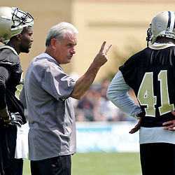 June 6, 2012; Metairie, LA, USA; New Orleans Saints assistant head coach Joe Vitt with safety Malcolm Jenkins (27) and safety Roman Harper (41) during a minicamp session at the team's practice facility. Mandatory Credit: Derick E. Hingle-US PRESSWIRE