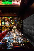 Dining room and, in the background, an open-air, garden bar and lounge at Baoli, Miami Beach
