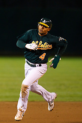 June 28, 2011; Oakland, CA, USA; Oakland Athletics center fielder Coco Crisp (4) runs to third base against the Florida Marlins during the sixth inning at the O.co Coliseum.  Oakland defeated Florida 1-0.