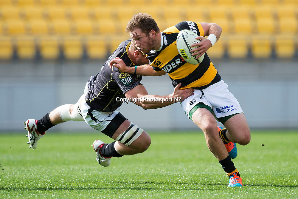 Taranaki's Marty McKenzie (R is tackled by Lions' captain Brad Shields during the Wellington v Taranaki ITM Cup rugby match at the Westpac Stadium in Wellington on Sunday the 5th of October 2014.  Photo by Marty Melville/www.Photosport.co.nz