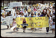 Kids and adults march in Earth Day parade with 'Save the Whale' banner; Forest Park, St. Louis. Missouri