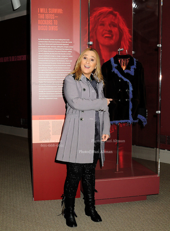 """Melissa Etheridge poses for a photo in front Etheridges' jacket she wore to the 2005 Grammy Award show. The jacket is part of the """"Women Who Rock"""" exhibition sponsored by the Rock and Roll Hall of Fame and the RIAA (Recording Industry Association of America) at NMWA in Wasington DC. Sunday Nov. 4th. Grammy award winner Melissa Etheridge is presented with The Excellence in the Performing Arts award from the National Museum of Women in the Arts (NMWA) in Washington DC. Sunday Nov. 4, 2012. Etheridge  also performed on the piano and then an acoustic set on guitar for an intimate audience of about 400 people. Photo ©Suzi Altman/For NMWA Grammy award winner Melissa Etheridge is presented with the National Museum of Women in the Arts' (NMWA) Award for Excellence in the Performing Arts in Washington DC. Sunday Nov. 4, 2012. Etheridge also performed on the piano and then an acoustic set on guitar for an intimate audience of about 300 people. Photo ©Suzi Altman/For NMWA<br /> <br /> Melissa Etheridge NMWA Award for Excellence in the Performing Arts"""