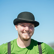 Portrait of a young magician busker in San Francisco