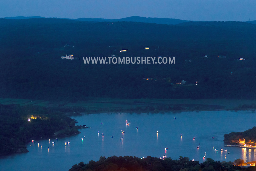 West Point, New York - Boats gather in the Hudson River to watch fireworks explode in the sky over the U.S. Military Academy at the end of the West Point Band's Fourth of July Celebration Concert on July 8, 2012. The photograph was taken from the Route 9W overlook.