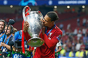CHAMPIONS Liverpool defender Virgil van Dijk (4) kisses the Champions League Trophy after the UEFA Champions League Final match between Tottenham Hotspur and Liverpool at Wanda Metropolitano Stadium, Madrid, Spain on 1 June 2019.