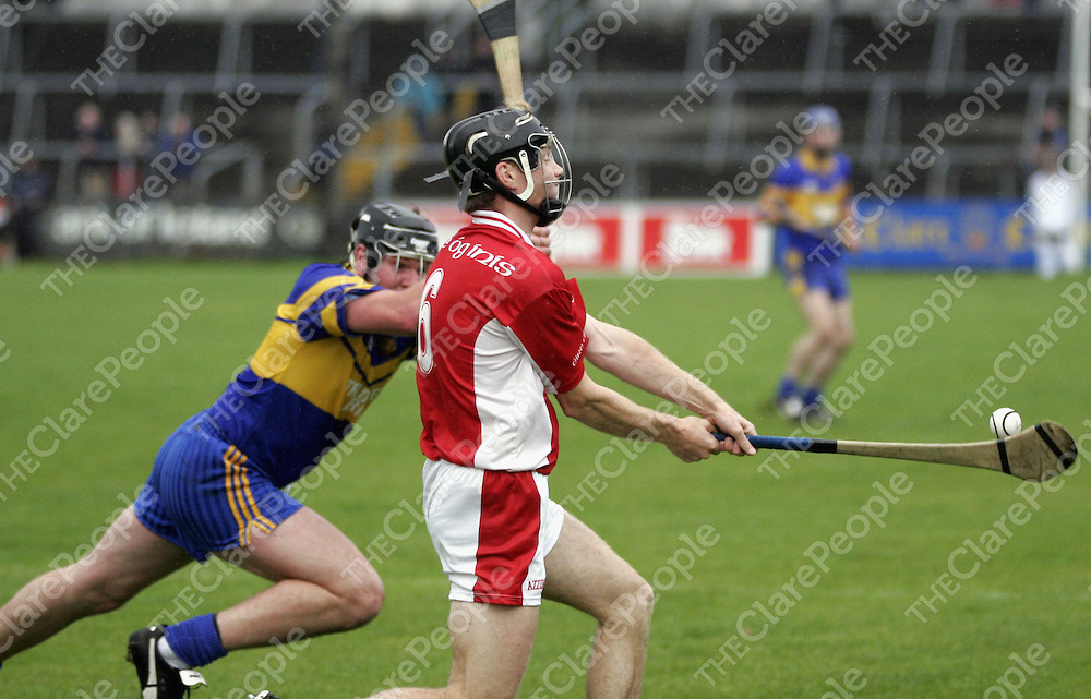 Newmarket's James McInerney goes for the block as Eire Og's Tadhg MacNamara  tries to get the  ball away in Cusack Park on Sunday.<br />