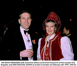 MR BRIAN ROBINSON CBE Chief Fire Officer and Chief Executive of the London Fire Brigade, and MRS MICHAEL CRIPPS at a ball in London on February 6th 1997.LWH 23