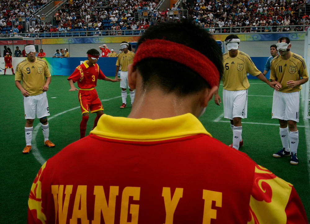 China's Wang Yafeng gets ready to take a corner during the  Football 5-A side match between China and Spain at the 2008 Beijing Paralympics Games in Beijing , China, Saturday, Sept.13, 2008. China won 1-0.(AP Photo/ Elizabeth Dalziel)