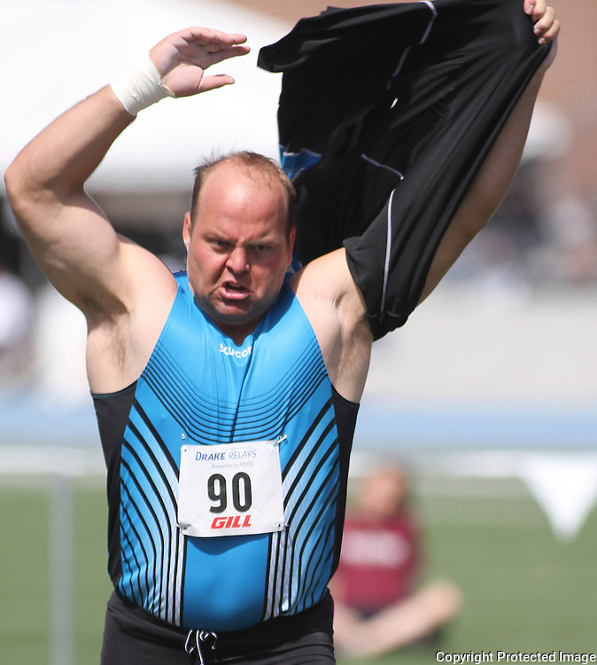 DRAKE RELAYS - 2011 - Adam Nelson went through his usual theatrics by ripping off his shirt before throwing the shot put.  Nelson won the event with a heave of 70.2.25.  photo by David Peterson