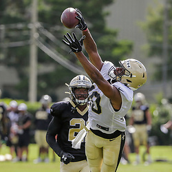 Jul 28, 2019; Metairie, LA, USA; New Orleans Saints wide receiver Tre'Quan Smith (10) works catches a pass over defensive back Patrick Robinson (21) during training camp at the Ochsner Sports Performance Center. Mandatory Credit: Derick E. Hingle-USA TODAY Sports