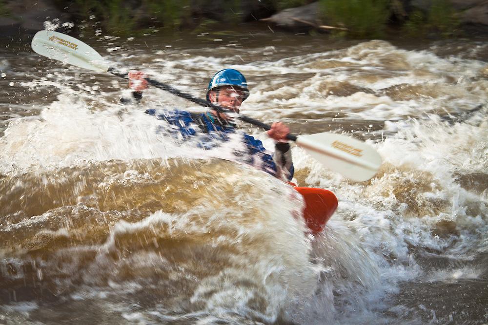 "A kayaker navigates a set of rapids on the ""Race Course"", Rio Grande near Pilar, New Mexico."