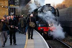 © Licensed to London News Pictures. 24/02/2016. London, UK. Rail enthusiasts gather to see The Flying Scotsman passing through Finsbury Park station in north London on Thursday, 24 February 2016. The Scotsman returs to the tracks for after a decade-long, £4.2 million refit which was completed earlier this year for its inaugural passenger service from King's Cross to York. Photo credit: Tolga Akmen/LNP