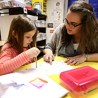 Adam Robison | BUY AT PHOTOS.DJOURNAL.COM<br /> Molly Beth Burks hleps Delilah Petty on her verb worksheet in class at Parkway Elementary School in Tupelo.