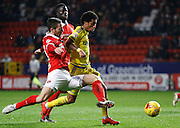 Charlton Athletic defender Harry Lennon gets in a vital tackle in against Nottingham Forest forward Ryan Mendes during the Sky Bet Championship match between Charlton Athletic and Nottingham Forest at The Valley, London, England on 2 January 2016. Photo by Andy Walter.