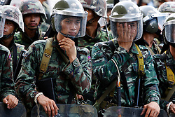 Thai soldiers adjust their helmuts as they prepare to crack down on anti-government protesters gathered outside Government House early morning in Bangkok, Thailand, 14 April 2009. Anti-government protests that shut down a weekend summit meeting and ruined Bangkok's annual Buddhist New Year celebrations ended suddenly 14 April after Thai army troops advanced on the demonstrators' last stronghold in Bangkok.