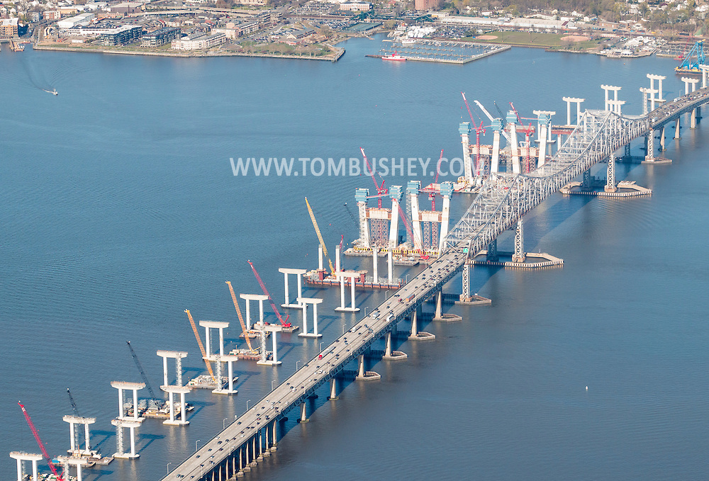 Tarrytown, New York - Construction continues on the new Tappan Zee Bridge over the Hudson River as traffic drives on the current bridge on April 20, 2016. The bridges connect South Nyack in Rockland County and Tarrytown in Westchester County.