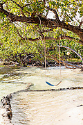 Rope swing along the beach in New Plymouth on Green Turtle Cay, Bahamas.