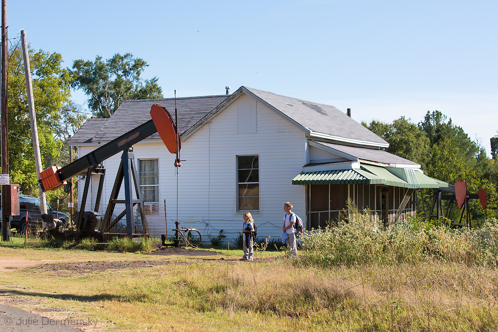 Children dropped off from school in front of their home in Hosston, Louisiana, part of the Haynsville Shale region..