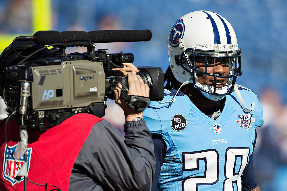 NASHVILLE, TN - DECEMBER 29:  Chris Johnson #28 of the Tennessee Titans warms up with a cameraman in his face before a game against the Houston Texans at LP Field on December 29, 2013 in Nashville, Tennessee.  The Titans defeated the Texans 16-10.  (Photo by Wesley Hitt/Getty Images) *** Local Caption *** Chris Johnson
