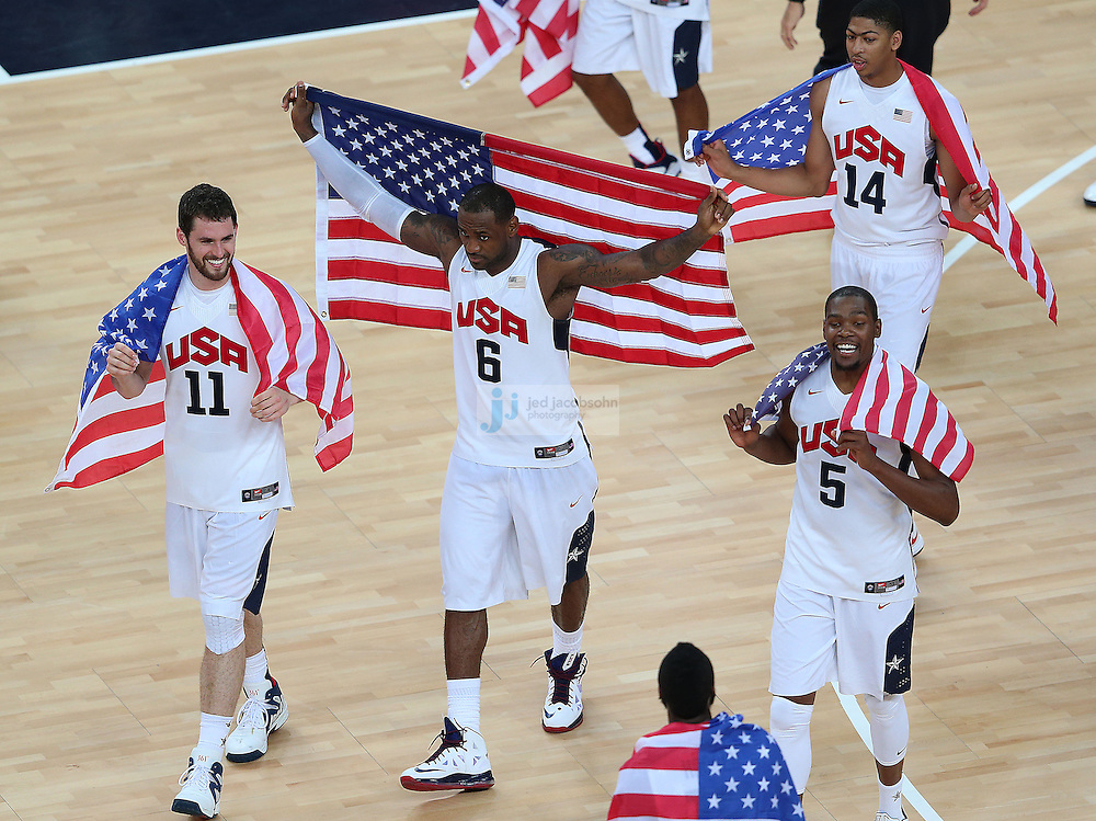The USA basketball team celebrates after defeating Spain during the men's final basketball game during day 16 of the London Olympic Games in London, England, United Kingdom on August 12, 2012..(Jed Jacobsohn/for The New York Times)..