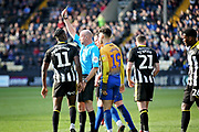 Referee Lee Mason shows the yellow card to Notts County midfielder Enzio Boldewijn (11) during the EFL Sky Bet League 2 match between Notts County and Mansfield Town at Meadow Lane, Nottingham, England on 16 February 2019.