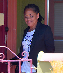 Meghan Markle's Mother Doria is picked up and carries a Burberry garment bag on her way to LAX. Her car is seen going through a private gate. 15 May 2018 Pictured: Doria Ragland. Photo credit: Snorlax/Rachpoot/ MEGA TheMegaAgency.com +1 888 505 6342