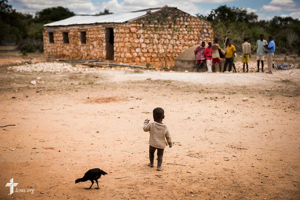 A young boy plays in the dirt next to a Fiangonana Loterana Malagasy (FLM, Malagasy Lutheran Church) church near Tsiombe, southern Madagascar, on Tuesday, Oct. 21, 2014. The church's tin roof was provided by The Lutheran Church–Missouri Synod. LCMS Communications/Erik M. Lunsford
