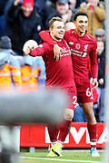 Liverpool midfielder Xherdan Shaqiri (23) celebrates his goal with Liverpool defender Trent Alexander-Arnold (66) 2-0 during the Premier League match between Liverpool and Fulham at Anfield, Liverpool, England on 11 November 2018.