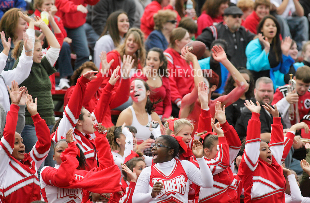 Thiells, New York - North Rockland cheerleaders, at bottom, and fans cheer for their team during a high school football game against Ramapo on Sept. 26, 2009.