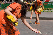 "The Virgins of the Sun scatter  petals to consecrate the path where the Inca will pass on his golden throne. Inti Raymi ""Festival of the Sun"", Plaza de Armas, Cusco, Peru."