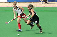 Emma Griffiths of Wales battles with Gemma Flynn of the Blacksticks during the pool B women's hockey match of the The Commonwealth Games between New Zealand and Wales held at the Stadium in New Delhi, India on the  October 2010..Photo by:  Ron Gaunt/SPORTZPICS/PHOTOSPORT