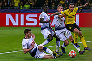 Tottenham Hotspur defender Toby Alderweireld (4) tackles Borussia Dortmund forward Paco Alcácer (9) during the Champions League round of 16, leg 2 of 2 match between Borussia Dortmund and Tottenham Hotspur at Signal Iduna Park, Dortmund, Germany on 5 March 2019.