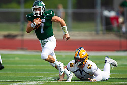 BLOOMINGTON, IL - September 28:  Brandon Bauer steps past grounded Matt Payton on a keeper run during a college football game between the IWU Titans and the Augustana Vikings on September 28 2019 at Wilder Field in Tucci Stadium in Bloomington, IL. (Photo by Alan Look)