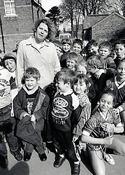 Teacher & children in playground, primary school Nottingham UK 1995