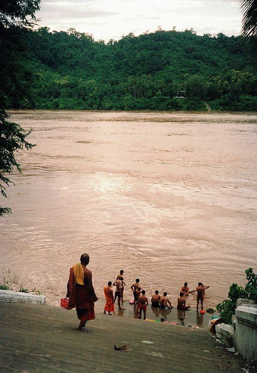 Monks bathing in the Mekong River.
