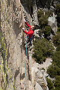 """Peter Croft climbing """"Wicked West of the Witch"""" (10+ X) on """"The Witch,"""" in The Needles of Southern California."""