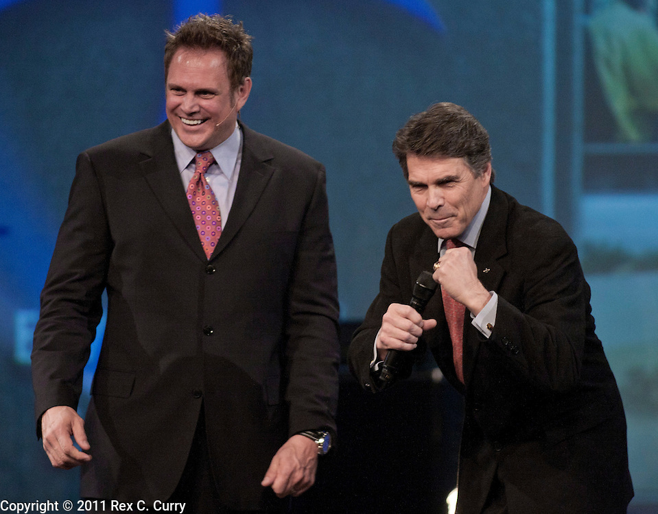 Texas Gov. Rick Perry, right, appears on stage with Pastor Keith Craft of the Elevate Faith Church in Frisco, Tx. on Jan 10, 2010.  While running for re-election for governor, Perry, said he wasn't interested in becoming president.  He is said he is considering running in 2012.
