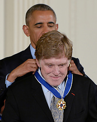 US President Barack Obama presents vocalist and musician Robert Redford with the Presidential Medal of Freedom, the nation's highest civilian honor, during a ceremony honoring 21 recipients, in the East Room of the White House in Washington, DC, November 22, 2016. Photo by Olivier Douliery/ABACA