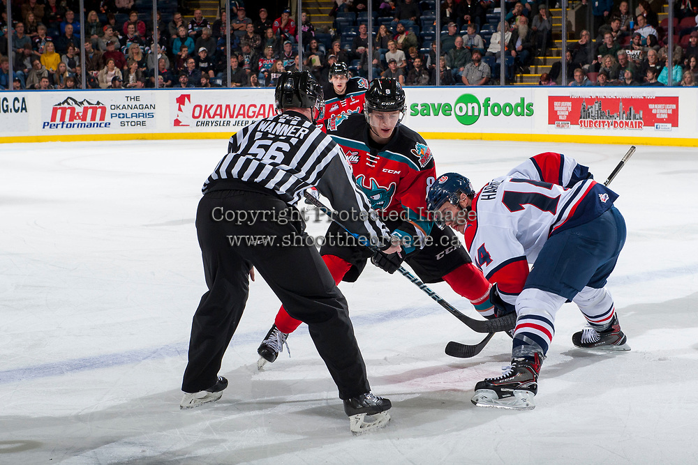 KELOWNA, CANADA - NOVEMBER 17: Jack Cowell #8 of the Kelowna Rockets faces off against Shawn Harke #14 of the Lethbridge Hurricanes on November 17, 2017 at Prospera Place in Kelowna, British Columbia, Canada.  (Photo by Marissa Baecker/Shoot the Breeze)  *** Local Caption ***