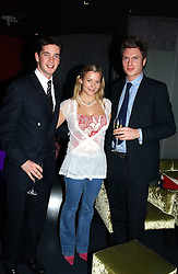 Left to right, the HON.JAMES TOLLEMACHE, LADY ROSE WINDSOR and GEORGE GILMAN at a party hosted by Panerai and the Baglioni Hotel, 60 Hyde Park Gate, London on 6th December 2004.<br />