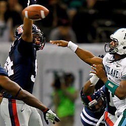 September 22, 2012; New Orleans, LA, USA; Tulane Green Wave quarterback Devin Powell (1) is pressured by Ole Miss Rebels defensive lineman Issac Gross (94) during the second quarter of a game at the Mercedes-Benz Superdome.  Mandatory Credit: Derick E. Hingle-US PRESSWIRE