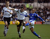 Photo: Kevin Poolman.<br />Derby County v Leicester City. Coca Cola Championship. 25/11/2006. Marc Edworthy of Derby and Leicester's Levi Porter fight it out.
