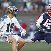 Kevin Drew #19 of the Charlotte Hounds controls the ball during the game at Harvard Stadium on May 17, 2014 in Boston, Massachuttes. (Photo by Elan Kawesch)