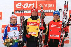 Winner Maxim Tchoudov, Emil Hegle Svendsen and Michael Greis at flower ceremony at Men 20 km Individual at E.ON Ruhrgas IBU World Cup Biathlon in Hochfilzen (replacement Pokljuka), on December 18, 2008, in Hochfilzen, Austria. (Photo by Vid Ponikvar / Sportida)
