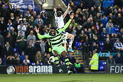 Forest Green Rovers Manny Monthe(3) jumps for the ball with Tranmere Rovers James Norwood(10) during the Vanarama National League match between Tranmere Rovers and Forest Green Rovers at Prenton Park, Birkenhead, England on 11 April 2017. Photo by Shane Healey.