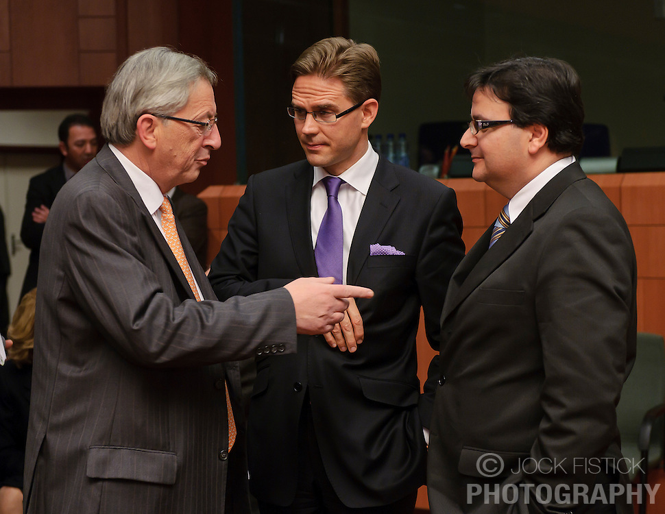 Jean-Claude Juncker, Luxembourg's prime minister, and president of the Eurogroup, left, speaks with Jyrki Katainen, Finland's finance minister, center, and Tonio Fenech, Malta's finance minister, right, during the Eurogroup meeting in Brussels, Monday Dec. 6, 2010. (Photo © Jock Fistick)