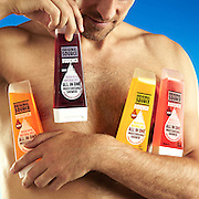 Model holding range of shower gels Ray Massey is an established, award winning, UK professional  photographer, shooting creative advertising and editorial images from his stunning studio in a converted church in Camden Town, London NW1. Ray Massey specialises in drinks and liquids, still life and hands, product, gymnastics, special effects (sfx) and location photography. He is particularly known for dynamic high speed action shots of pours, bubbles, splashes and explosions in beers, champagnes, sodas, cocktails and beverages of all descriptions, as well as perfumes, paint, ink, water – even ice! Ray Massey works throughout the world with advertising agencies, designers, design groups, PR companies and directly with clients. He regularly manages the entire creative process, including post-production composition, manipulation and retouching, working with his team of retouchers to produce final images ready for publication.