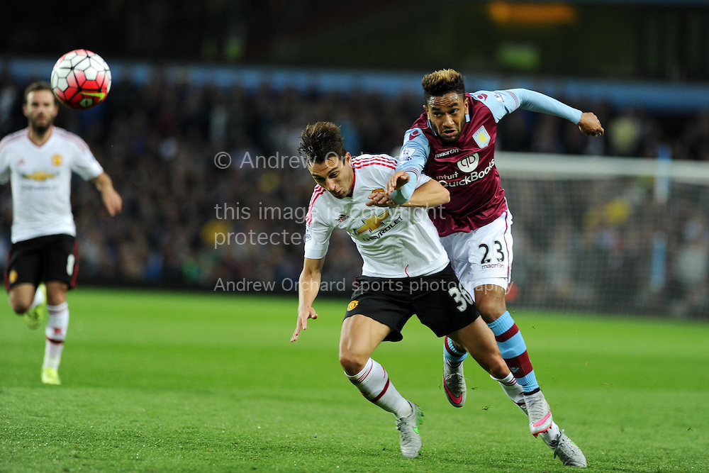 Jordan Amavi of Aston Villa &reg; challenges Matteo Darmian of Manchester Utd.Barclays Premier League match, Aston Villa v Manchester Utd at Villa Park in Birmingham, Midlands on Friday 14th August  2015.<br /> pic by Andrew Orchard, Andrew Orchard sports photography.